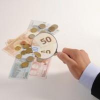 Pixelio Bild Lupe und Geld Jorma Bork